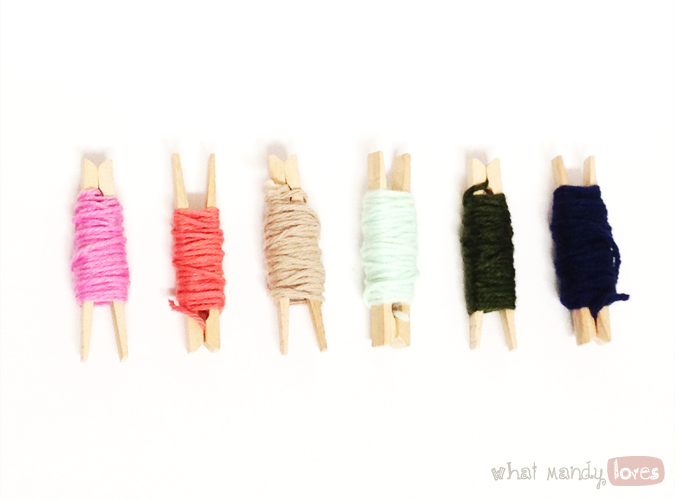 What Mandy Loves: Image of some of yarn scraps wrapped around clothespins via www.whatmandyloves.com