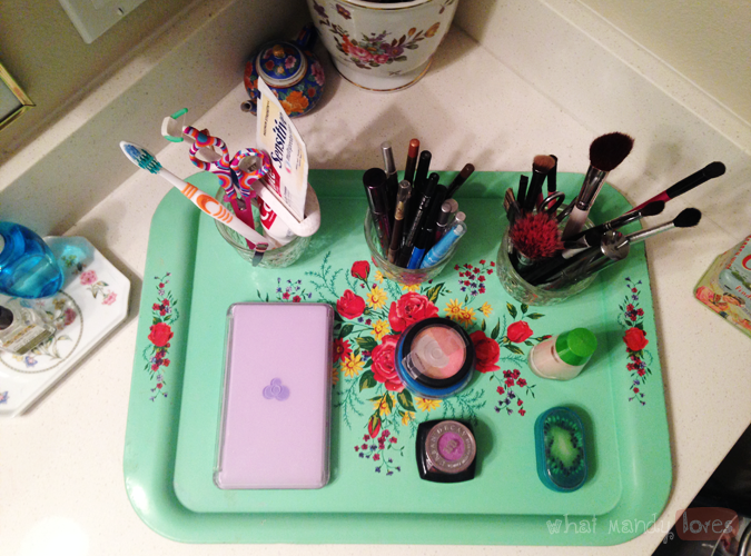 What Mandy Loves: Image of my makeup products organized on a thrifted floral tray via www.whatmandyloves.com